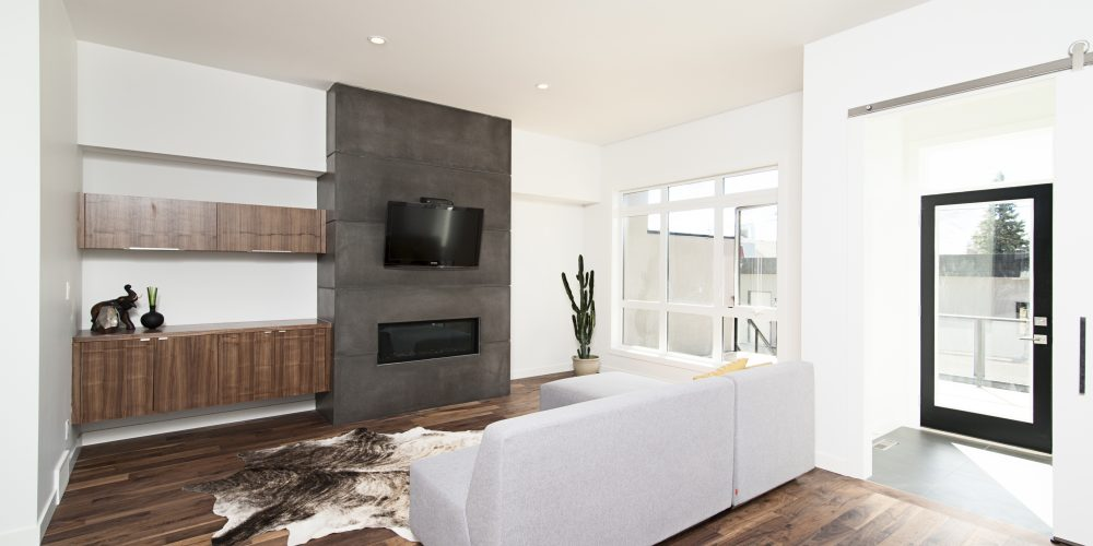 A beautiful interior shot of a modern house with white relaxing walls and furniture and technology